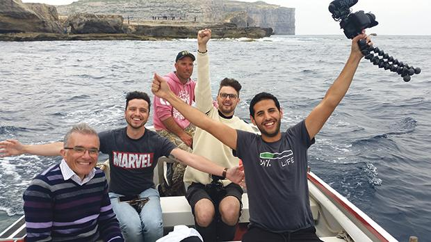 With the Nas Daily team and the mayor of San Lawrenz, Nas (right) enjoys a boat ride on the Gozitan coast.