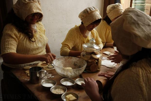 Schoolgirls in costume learn about Victorian-era baking during a visit to the Fort Rinella coastal battery, built in 1878, in Kalkara on April 27. Photo: Darrin Zammit Lupi