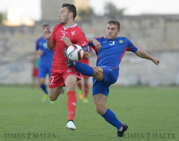 Malta's Ryan Camenzuli (left), and Moldova's Ion Burlacu vie for the ball during their UEFA U21 Championship group match at the Hibernians Stadium in Corradino on October 11. Photo: Matthew Mirabelli
