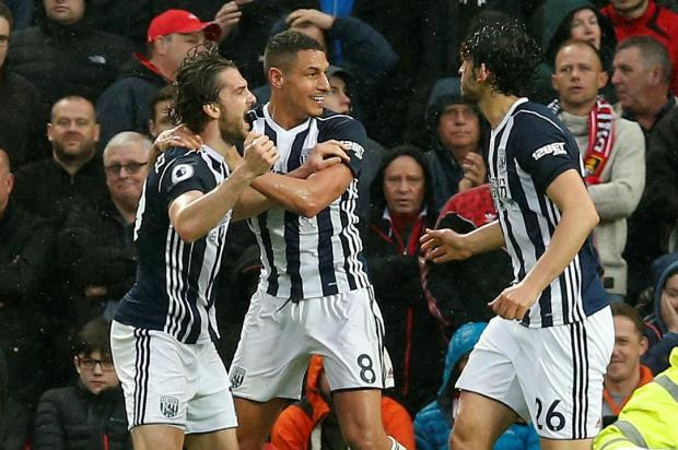 West Brom players celebrate their victory against Manchester United at Old Trafford.