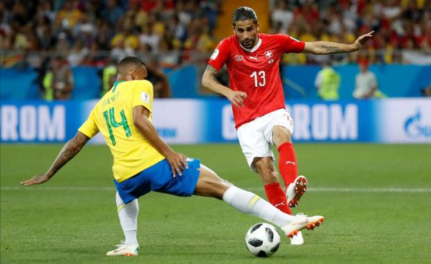 Switzerland's Ricardo Rodriguez in action with Brazil's Danilo. Reuters file photo