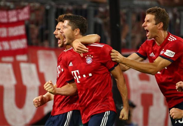 Robert Lewandowski (centre) celebrates his goal against Hoffenheim.