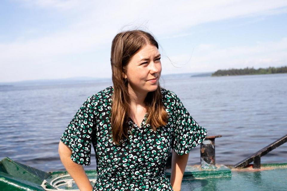 Utoya massacre survivor Astrid Eide Hoem stands on a ferry on June 7, 2021 heading for the island (in the background) where far-right extremist Anders Behring Breivik killed 69 of his 77 victims in 2011.