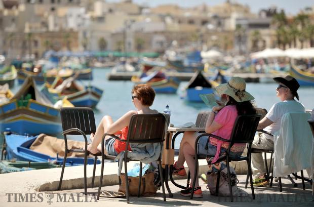 Tourists enjoy the warm spring weather at Marsaxlokk on April 18. Photo: Chris Sant Fournier