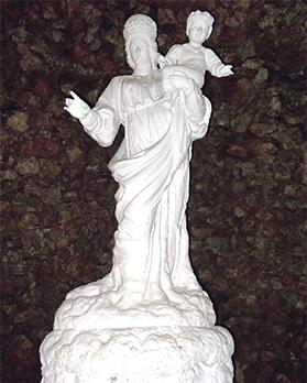 The white statue of Our Lady holding Baby Jesus in her left arm. In the sanctuary archives there are 13 detailed documents attesting to occurences when Our Lady and/or Baby Jesus were seen moving their arms to make the sign of the cross.