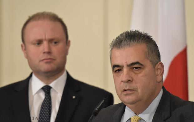 Michael Falzon reiterated his innocence soon after resigning from his post as parliamentary secretary, as Prime Minister Joseph Muscat looks on during a press conference at Castille in Valletta on 20 January Photo: Mark Zammit Cordina