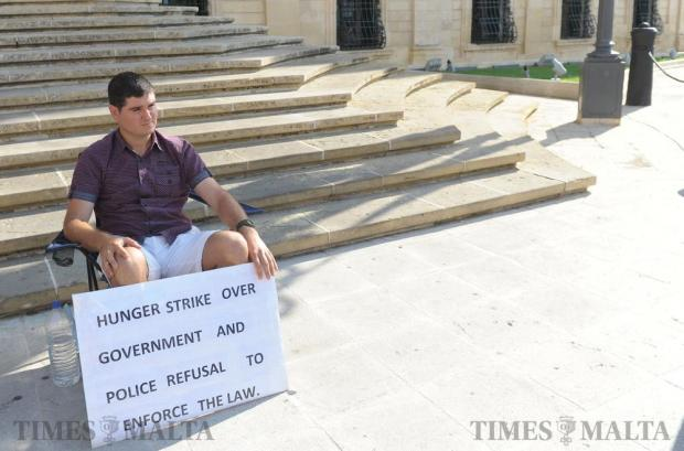 Dean Camilleri sits outside the Office of the Prime Minister at Auberge de Castille on a hunger strike protesting against the lack of enforcement regarding noise pollution in St Julian's on September 27. The protest lasted for just over an hour as shortly after Prime Minister Joseph Muscat invited Dean into his office to discuss the situation