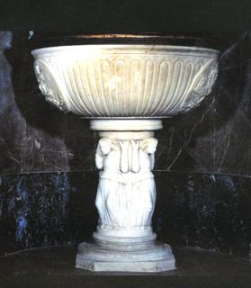A baptismal font (1474) from the Palermo workshop of the renowned Domenico Cagini.