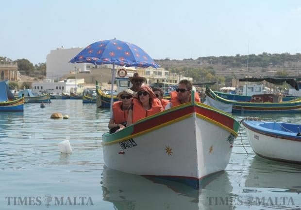 Tourists enjoy a ride on a fishing boat at the Fish Festival in Marsaxlokk on September 12. Photo: Matthew Mirabelli