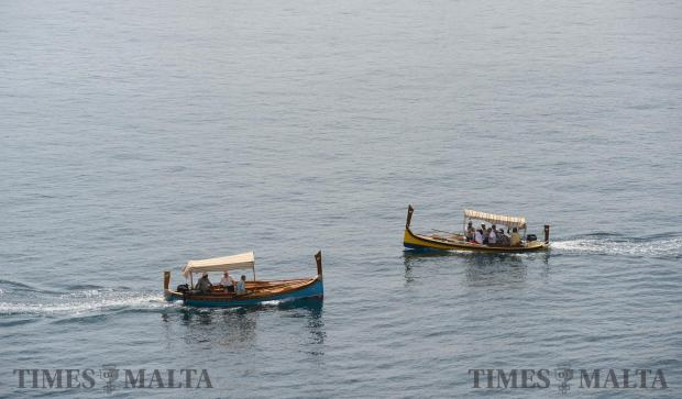 Two traditional Luzzu's cross paths in the Grand Harbour on June 1. Photo: Matthew Mirabelli