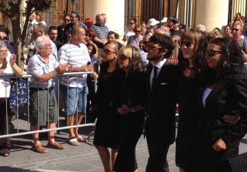 Mr Mintoff's daughters Anne and Yana follow the coffin.