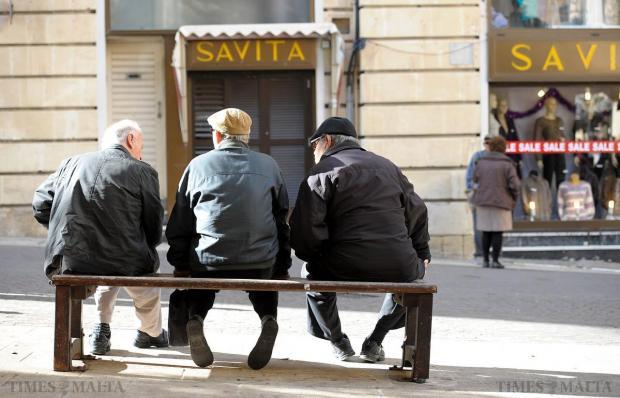 Three men sit on a bench in Valletta on December 27. Photo: Matthew Mirabelli