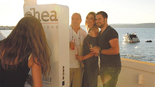 Guests posed for photos by O'hea Opticians, with a stunning backdrop of the sea, sunset and the sister island.