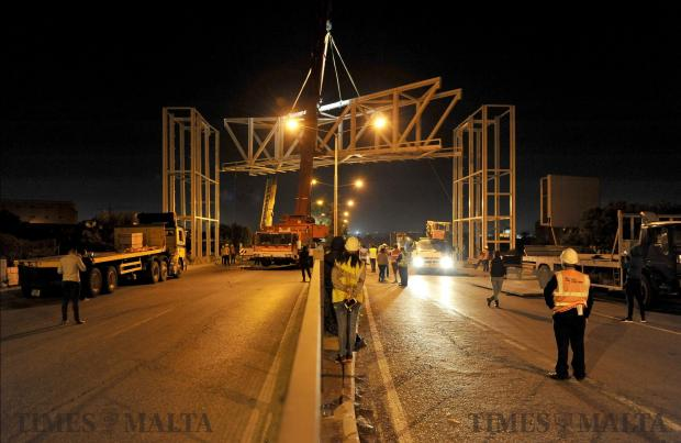The Mriehel bridge walkway is lifted into position by a crane on April 26. Photo: Chris Sant Fournier