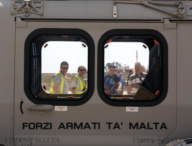 People look at an Armed Forces of Malta AW139 helicopter at the Malta International Airshow at Malta International Airport on September 24. Photo: Darrin Zammit Lupi