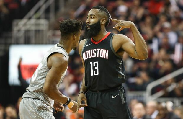 Houston Rockets guard James Harden (13) celebrates after scoring as Minnesota Timberwolves guard Jimmy Butler (23) loos on during the first quarter against the in game one of the first round of the 2018 NBA Playoffs at Toyota Center. Photo Credit: Troy Taormina-USA TODAY Sports