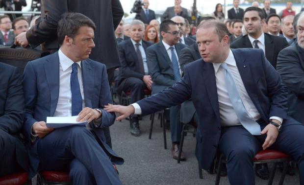 Prime Minister Joseph Muscat reaches over to Italian Prime Minister Matteo Renzi during the opening of the Malta-Sicily interconnector project. The 95-kilometre (59 mi) long subsea cable starts at Magħtab, Qalet Marku in Malta and runs to Marina di Ragusa in Sicily. Photo: Matthew Mirabelli