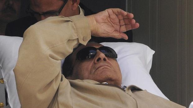 Mubarak seen on a stretcher in court this morning.