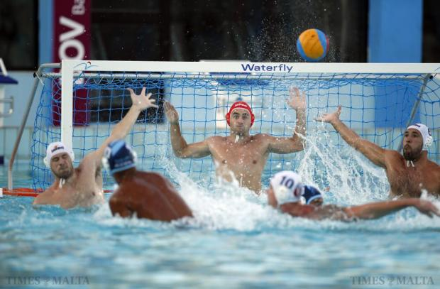 Neptunes'goalkeeper Alan Borg Cole (centre) keeps a close watch on the ball during a Sliema attack during their waterpolo national league match at the National Pool in Tal-Qroqq on July 29. Photo: Darrin Zammit Lupi