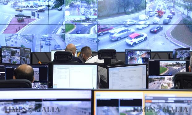 Transport Malta employees keep an eye on the new traffic control centre at Transport Malta's headquarters in Paola on November 9. The system monitors the roads on a 24-hour basis with 27 cameras and will be fully operational in January. Photo: Matthew Mirabelli