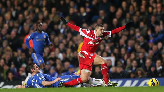 Queens Park Rangers' Adel Taarabt (right) and Chelsea's Frank Lampard (left) battle for the ball during the Barclays Premier League match at Stamford Bridge, London. Photo: Nick Potts, PA Wire