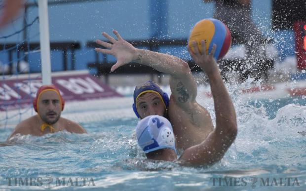 San Gilian's Matthew Zammit attempts to block Sliema's Jerome Gabarretta during a waterpolo match at the National Pool in Tal-Qroqq on July 13. Photo: Mark Zammit Cordina