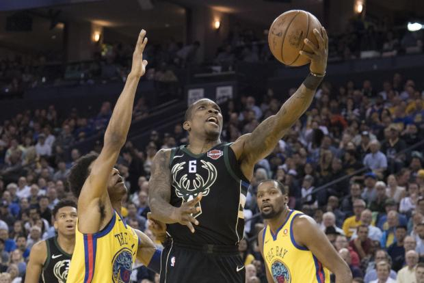 Milwaukee Bucks guard Eric Bledsoe (6) shoots the basketball against Golden State Warriors guard Patrick McCaw (0) and forward Kevin Durant (35) during the second quarter at Oracle Arena. Photo Credit: Kyle Terada-USA TODAY Sports