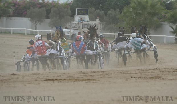 Horses and their jockeys make their way around the first bend during a race at the Marsa Race track on October 23. Photo: Matthew Mirabelli