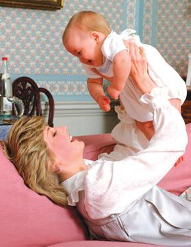 Cute shot of Princess Diana holding baby William.