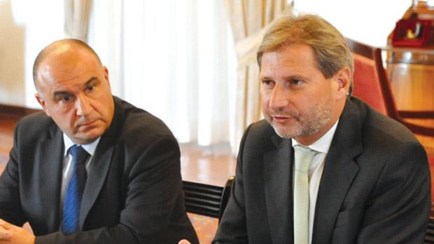 EU Regional Policy Commissioner Johannes Hahn (right) with Martin Bugelli, Head of EU Representation, during the meeting with Prime Minister Lawrence Gonzi at the Auberge de Castille in Valletta, yesterday.