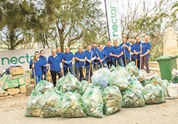 Nectar's staff with the bags full of garbage collected at the end of the clean-up activity.