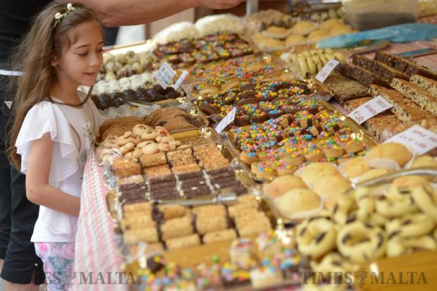 A girl stares at an assortment of sweets on display at the Fish Festival in Zurrieq held on June 5. Photo: Matthew Mirabelli