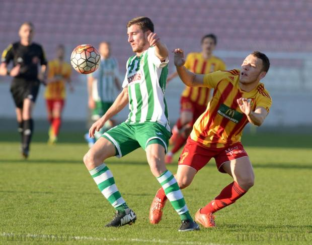 Floriana's Emanuel Briffa (left) keeps the ball away from Birkirkara's Ryan Camenzuli. during their Premier League match at the National Stadium in Ta' Qali on January 31 Photo: Matthew Mirabelli