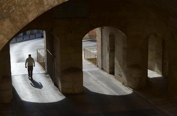 A man walks through Victoria Gate in Valletta on December 27. Photo: Matthew Mirabelli