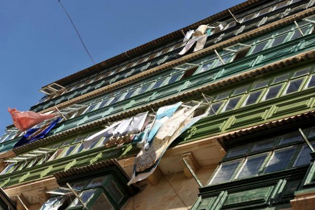 Clothes hang to dry from wooden Maltese balconies in Valletta on October 12. Photo: Chris Sant Fournier