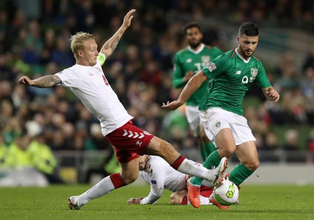 Republic of Ireland's Shane Long in action with Denmark's Simon Kjaer