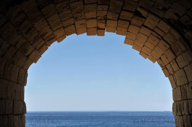 The sea and sky are seen through a tunnel in Rinella on July 20. Photo: Chris Sant Fournier