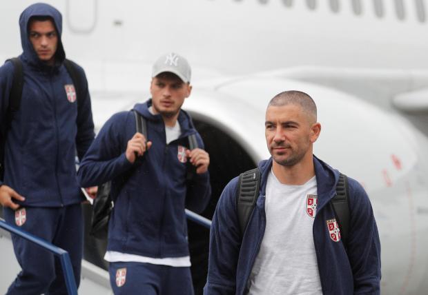 Aleksandar Kolarov and his team mates disembark from a plane.