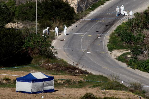 Forensics combing the area after the car bomb on October 16. Photo: Reuters