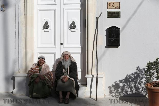 Participants sit on a doorstep while waiting for the start of a Good Friday procession in Zebbug on March 25. Photo: Darrin Zammit Lupi
