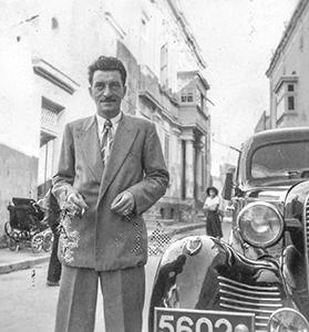 John Salerno standing by his cousin's car in a street in Siġġiewi. Photo: Gloria Callus Collection