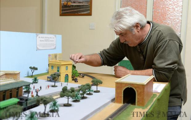 A member of the Model Railways Group tinkers with his working layout of the old Hamrun train station, once part of the Malta Railway at their premises in Paola on December 17. Photo: Matthew Mirabelli