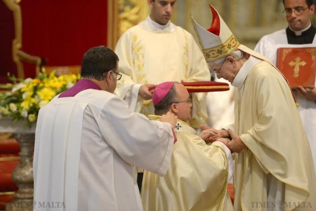 Archbishop Charles Scicluna receives the pallium from Nuncio Mario Roberto Cassari which was blessed by the Pope. The woolen vestment is given to newly appointed archbishops and was presented to the Archbishop at St John's Co Cathedral on July 11. Photo: Matthew Mirabelli