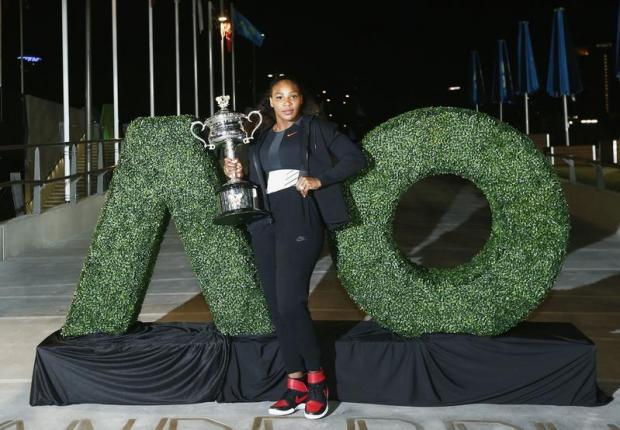 Serena Williams of the U.S. poses with the Women's singles trophy after winning her final match.