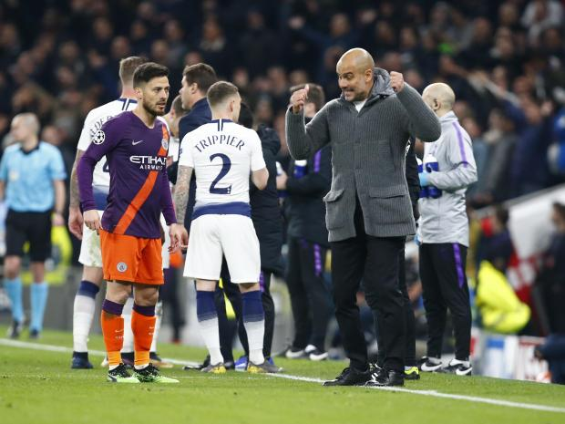 Manchester City manager Pep Guardiola having words with Manchester City's David Silva.