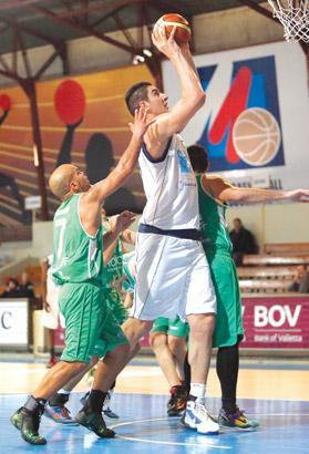 Sam Deguara pots a basket for Luxol in the first leg of their Louis Borg Cup semi-final against Floriana. Photo: Darrin Zammit Lupi
