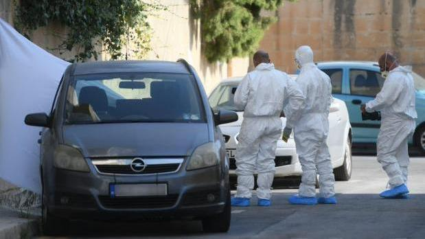 Forensic experts at the site of the murder.