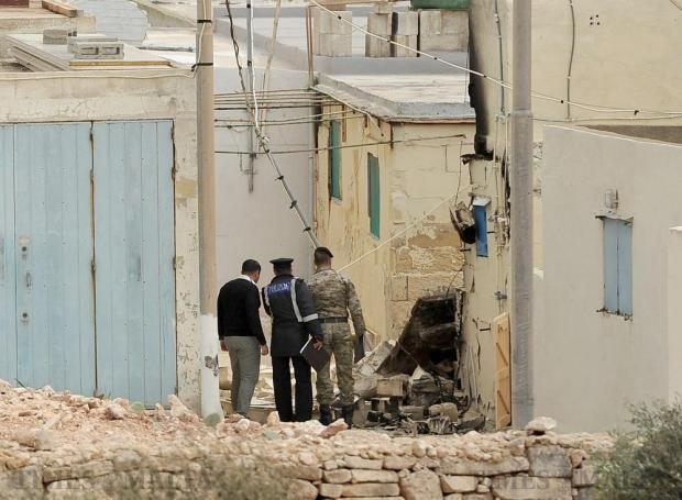 Experts from the police and Bomb Disposal Unit examine the damage caused by a bomb placed outside a boathouse owned by a 38-year-old man from Attard in Armier on March 23. Photo: Chris Sant Fournier