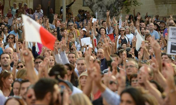 Thousands gather at a national rally to demand justice for murdered blogger Daphne Caruana Galizia in Valletta on October 22. Photo: Matthew Mirabelli