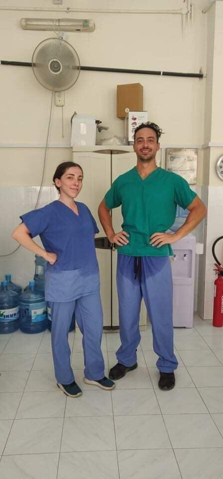 Martina Agius and a colleague in drenched scrubs after a swabbing shift. Photo courtesy of Martina Agius